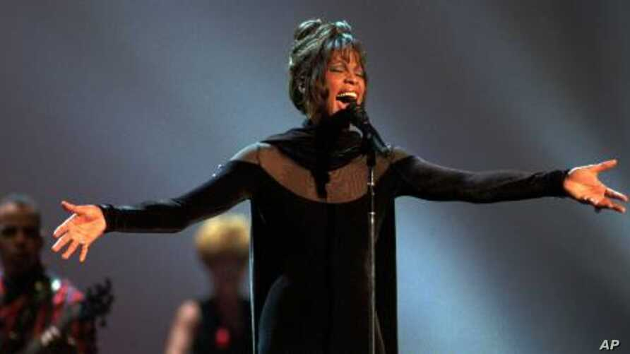 Whitney Houston performs during the 21st annual American Music Awards at the Shrine Auditorium Feb. 7, 1994 in Los Angeles.