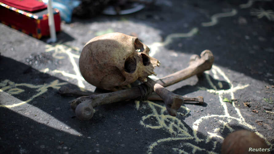 FILE - A skull and bones for a voodoo ritual are pictured in Port-au-Prince, Haiti, Dec. 16, 2016.