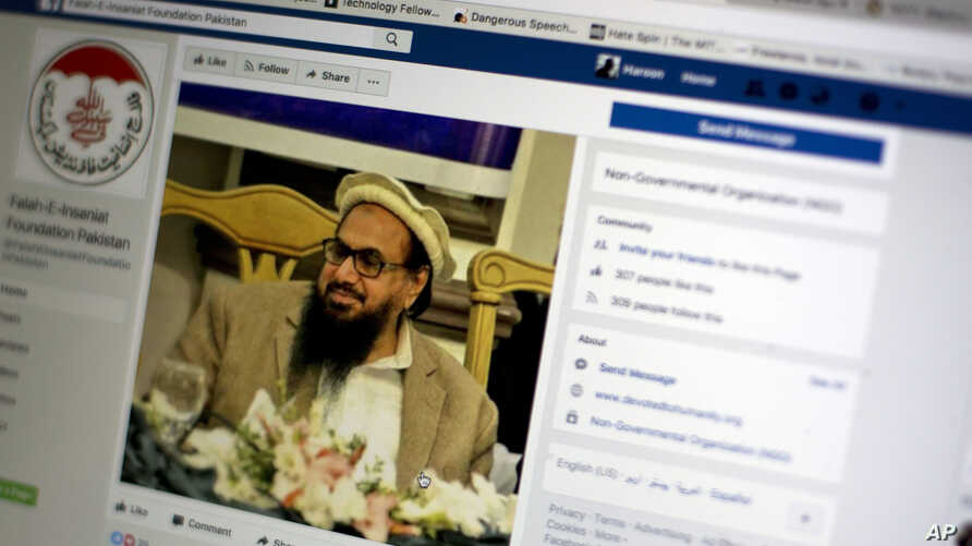 A photo shows a Facebook site that features one of India's most wanted, Hafiz Saeed, the founder of Lashkar-e-Taiba, a banned organization and a U.S. declared terrorist group, in Islamabad, Pakistan, July 7, 2017. A senior Pakistani government offi...
