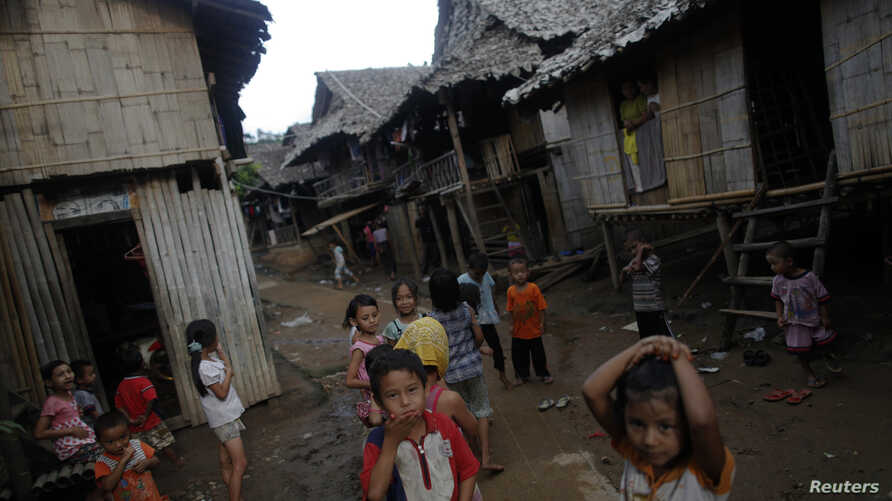 FILE - Ethnic Karen refugee children from Myanmar pass the time at the Mae La camp outside Mae Sot near the Thai-Myanmar border, Oct. 14, 2010.