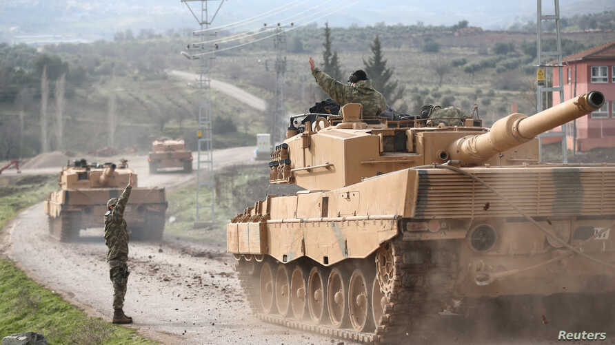 A Turkish military convoy arrives at a village on the Turkish-Syrian border in Kilis province, Turkey, Jan. 21, 2018.