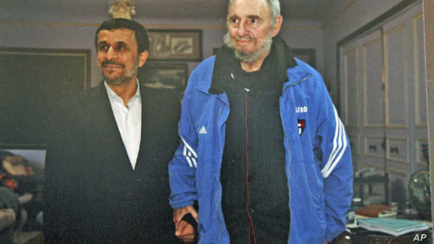 Iran's President Mahmoud Ahmadinejad (L) stands with former Cuban leader Fidel Castro, in Cuba, January 12, 2012.