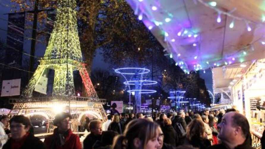 Shoppers visit the Christmas market along the Champs Elysees in Paris, December 3, 2011.