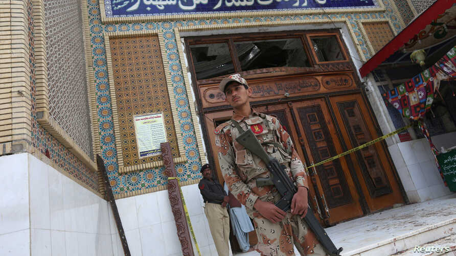 FILE - A paramilitary soldier stands guard in Sehwan Sharif, Pakistan's southern Sindh province, Feb. 17, 2017.