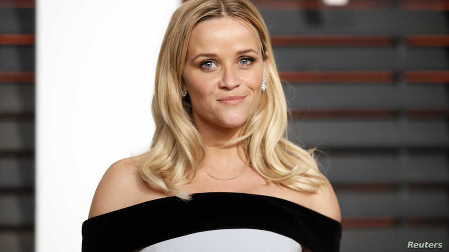 FILE - Actress Reese Witherspoon arrives at the 2015 Vanity Fair Oscar Party in Beverly Hills, California.