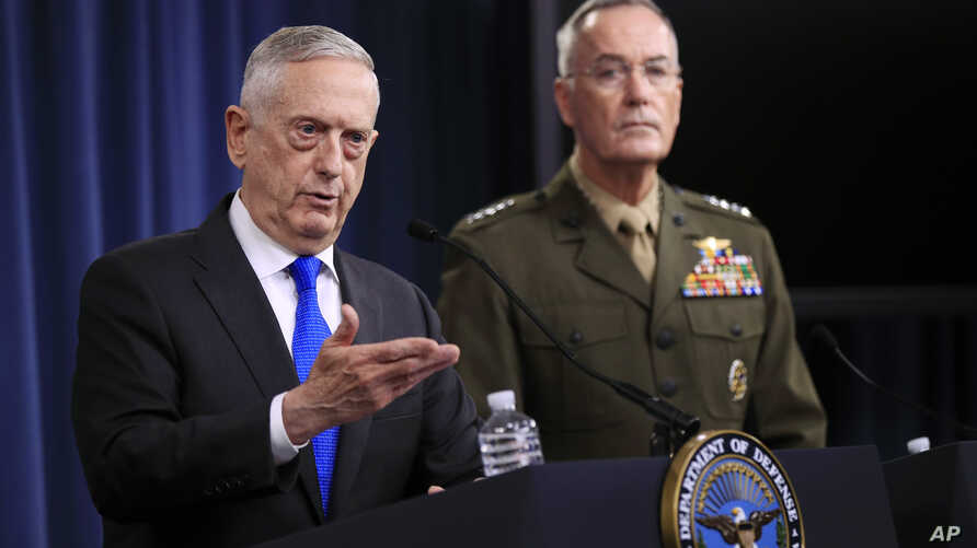 Secretary of Defense Jim Mattis, left, and Chairman of the Joint Chiefs of Staff, Marine Gen. Joseph Dunford speak to reporters during a news conference at the Pentagon, Aug. 28, 2018, in Washington.