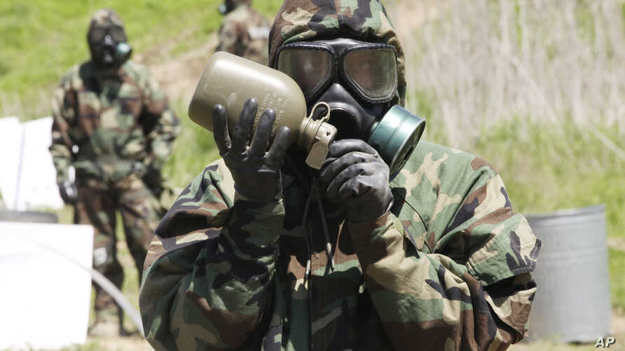 FILE - A U.S. Army soldier drinks waters during a CBR (chemical, biological and radiological) warfare training exercise at Yeoncheon near the border with North Korea, in South Korea, May 16, 2013.
