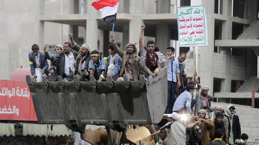Followers of the Shi'ite Houthi movement ride a bulldozer they took from riot police during clashes along a main road leading to the airport in Sana'a Sept. 7, 2014.