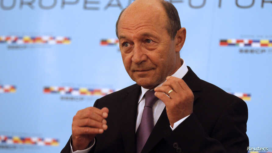 Romania's President Traian Basescu gestures at Cotroceni presidential palace ahead of the Summit of heads of state and goverment of the states participating in the South-East Europe Cooperation Process (SEECP) in Bucharest, June 25, 2014.