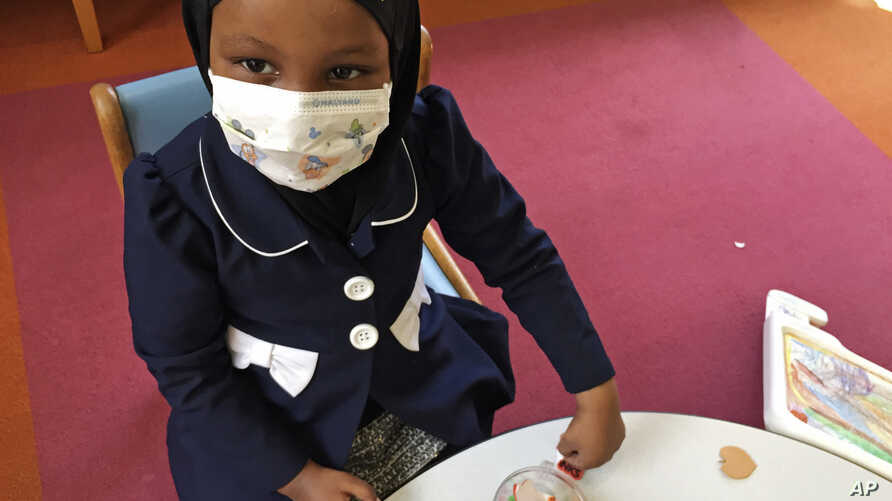Amira Hassan, of Burnsville, Minnesota, plays in the waiting room at the specialty clinic at Children's Minnesota in Minneapolis, Minnesota, May 2, 2017.