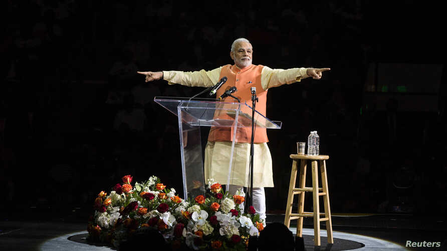 India's Prime Minister Narendra Modi gestures while speaking at Madison Square Garden in New York, during a visit to the United States, Sept. 28, 2014.