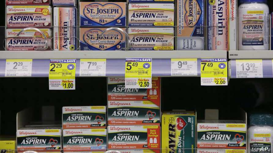 Packages of aspirin fill the shelves of a drugstore, Tuesday, Aug. 11, 2009 in Chicago