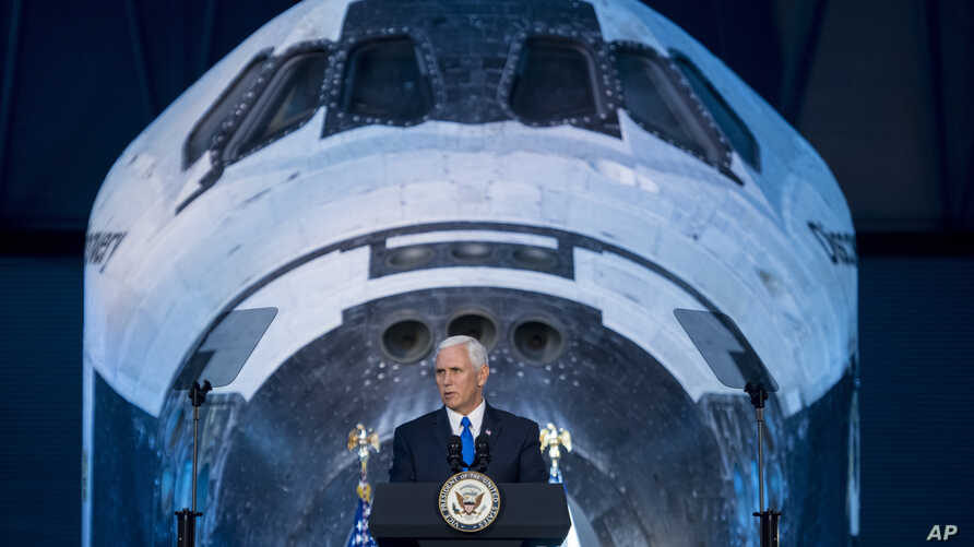 Vice President Mike Pence delivers opening remarks during the National Space Council's first meeting at the Smithsonian National Air and Space Museum's Steven F. Udvar-Hazy Center in Chantilly, Va., Oct. 5, 2017.