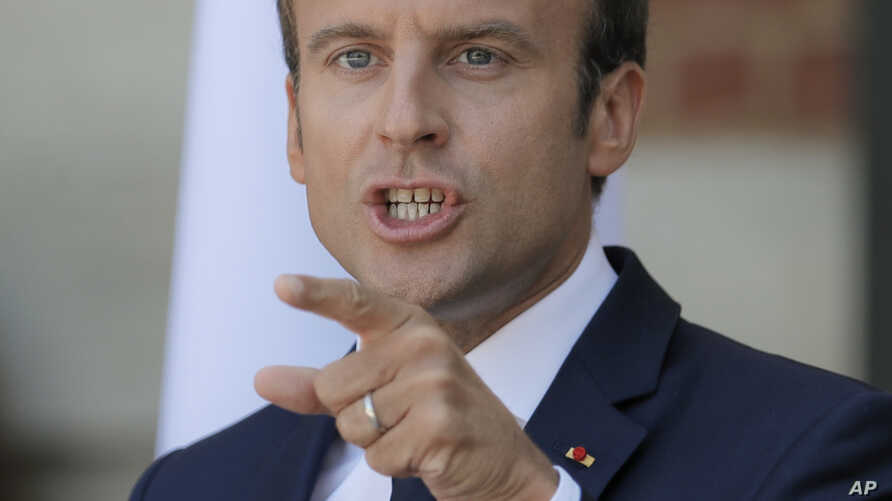French President Emmanuel Macron gestures during a press conference with his Bulgarian counterpart Rumen Radev at the Euxinograd residence outside Varna, Bulgaria, Aug. 25, 2017.