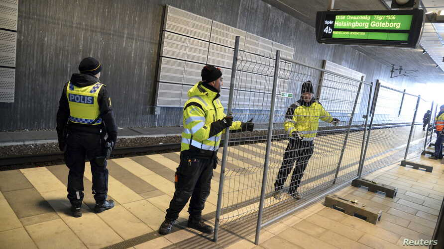 A temporary fence is erected between domestic and international tracks is seen at Hyllie train station in southern Malmo, Sweden, Jan. 3, 2016.