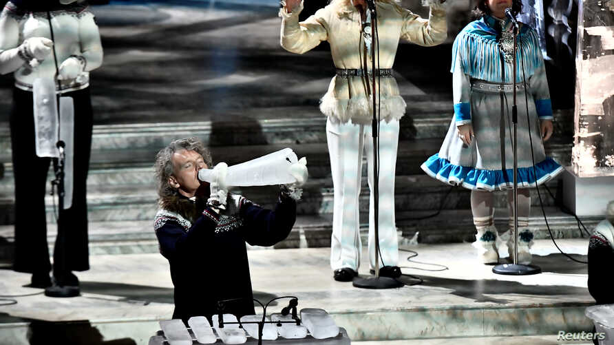 Terje Isungset preforms with ice instruments during the Nobel Banquet at the City Hal in Stockholm, Sweden, Dec. 10, 2017.