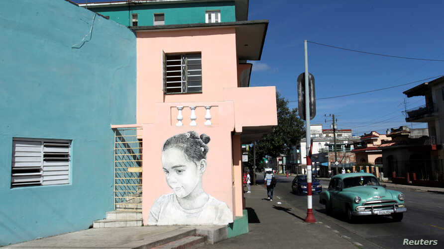 A painting by Cuban artist Maisel Lopez is seen on a street wall in Havana, Cuba, April 20, 2017.
