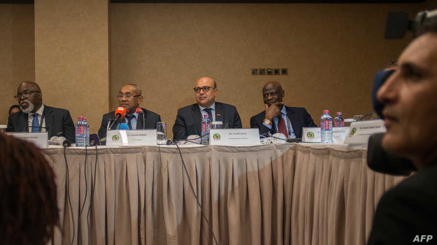 Vice President of the Confederation of African Football (CAF) Amaju Pinnink, President of CAF Ahmad Ahmad and Acting general secretary of CAF Essadik Alaoui look on during a press conference after an extraordinary meeting with CAF executives at the K