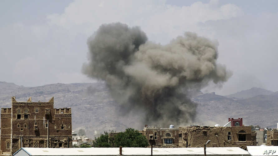 Smoke billows from buildings after reported airstrikes by the Saudi-led coalition on arms warehouses at Al-Dailami air base, north of the capital Sana'a, Sept. 29, 2015.