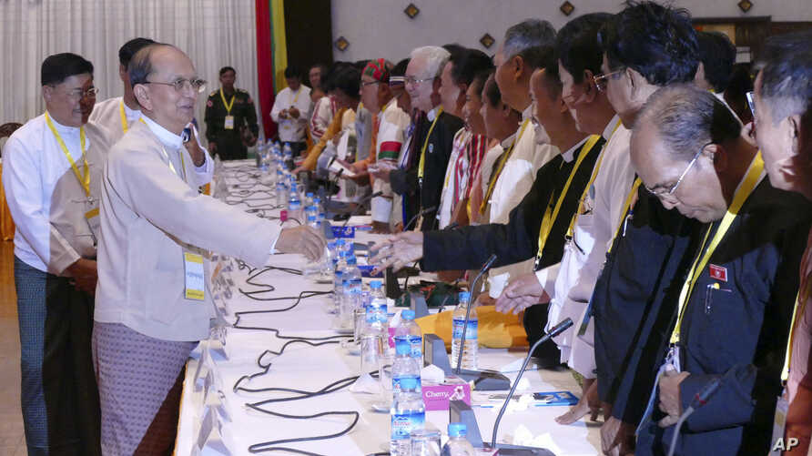 Myanmar President Thein Sein, front left, greets representatives of political parties during a meeting at Yangon region government office in Yangon, Myanmar, Nov. 15, 2015.