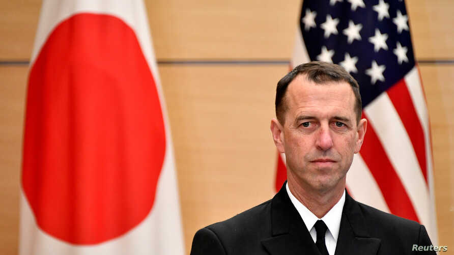 FILE - Admiral John Richardson, chief of U.S. Naval Operations, waits for Japan's Prime Minister Shinzo Abe before their meeting at the prime minister's official residence in Tokyo, Dec. 18, 2017.