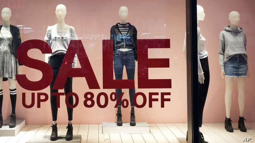 FILE -An H&M store window advertises a sale, in New York, Jan. 11, 2017.