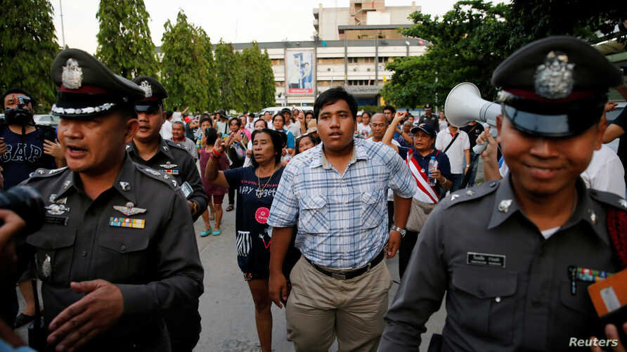 FILE - Anti-junta activist Sirawith Seritiwat (C) takes part in a demonstration asking for the release of his mother Patnaree Chankij, in Bangkok, Thailand on May 7, 2016.