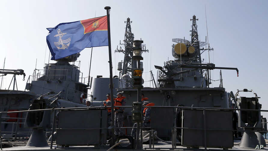 "FILE -  Montenegrin sailors stand at the frigate ""Kotor"" in the harbor of Bar, Montenegro, March 15, 2017. Montenegro is set to become NATO's newest member after the U.S. Senate voted overwhelmingly March 28 to ratify the tiny Balkan nation's entry i"