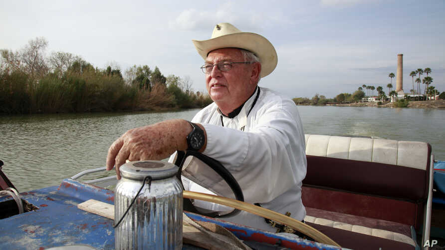 In this Jan. 8, 2019 photo, father Roy Snipes, pastor of the La Lomita Chapel, shows Associated Press journalists the land on either side of the Rio Grande at the US-Mexico border in Mission, Texas.