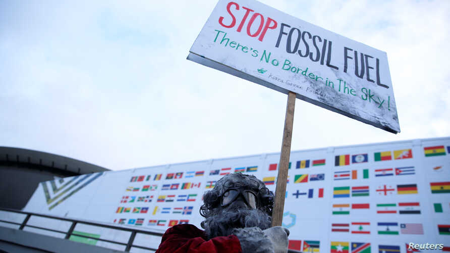 Environmental activist protests against fossil fuel in front of the the venue of the COP24 UN Climate Change Conference 2018 in Katowice, Poland, Dec. 10, 2018. (Agencja Gazeta/Grzegorz Celejewski via Reuters)
