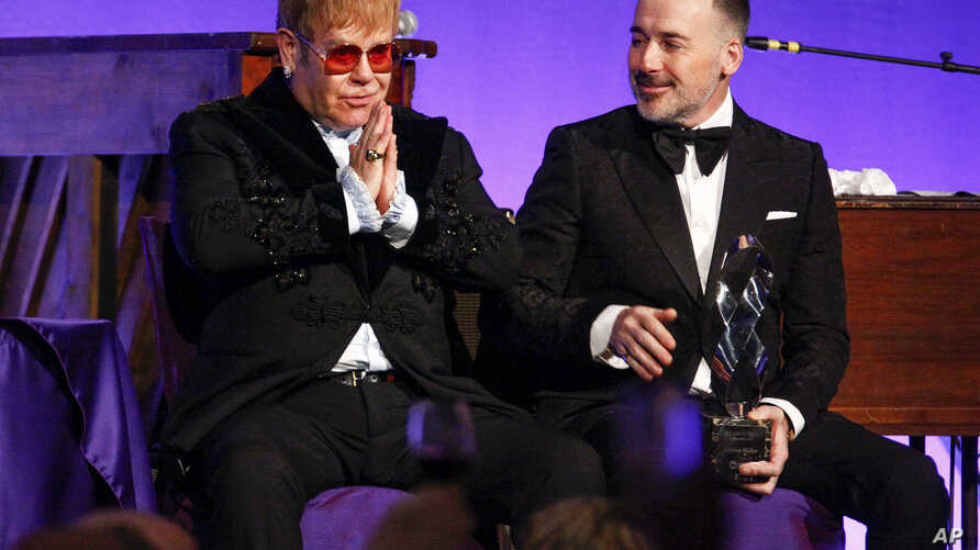 """Elton John, left, and David Furnish attend the Elton John AIDS Foundation's 17th annual """"An Enduring Vision"""" benefit gala at Cipriani 42nd Street in New York, Nov. 5, 2018."""