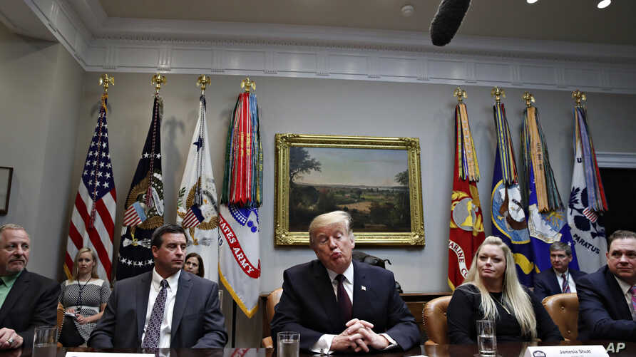 President Donald Trump, center, at the during a healthcare roundtable in the Roosevelt Room of the White House, Wednesday, Jan. 23, 2019, in Washington.