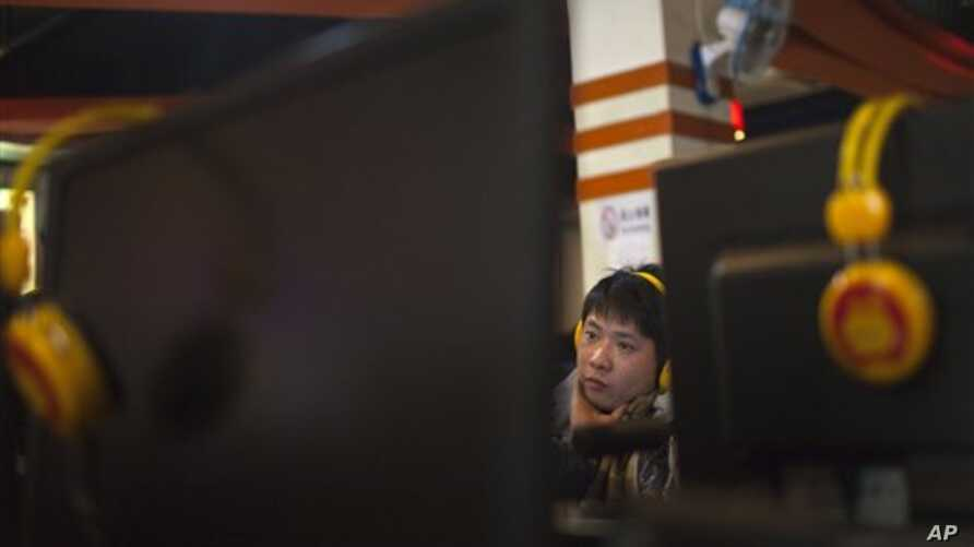 A man uses a computer at an internet cafe in central Beijing, China, Friday, Dec. 28, 2012. China's new communist leaders are increasing already tight controls on Internet use and electronic publishing following a spate of embarrassing online reports