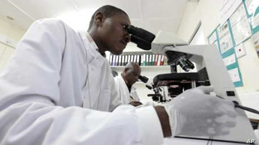 Kenya Medical Research Institute doctors research malaria at the clinical research facility laboratory in the Kenya coastal town of Kilifi, November 23, 2010
