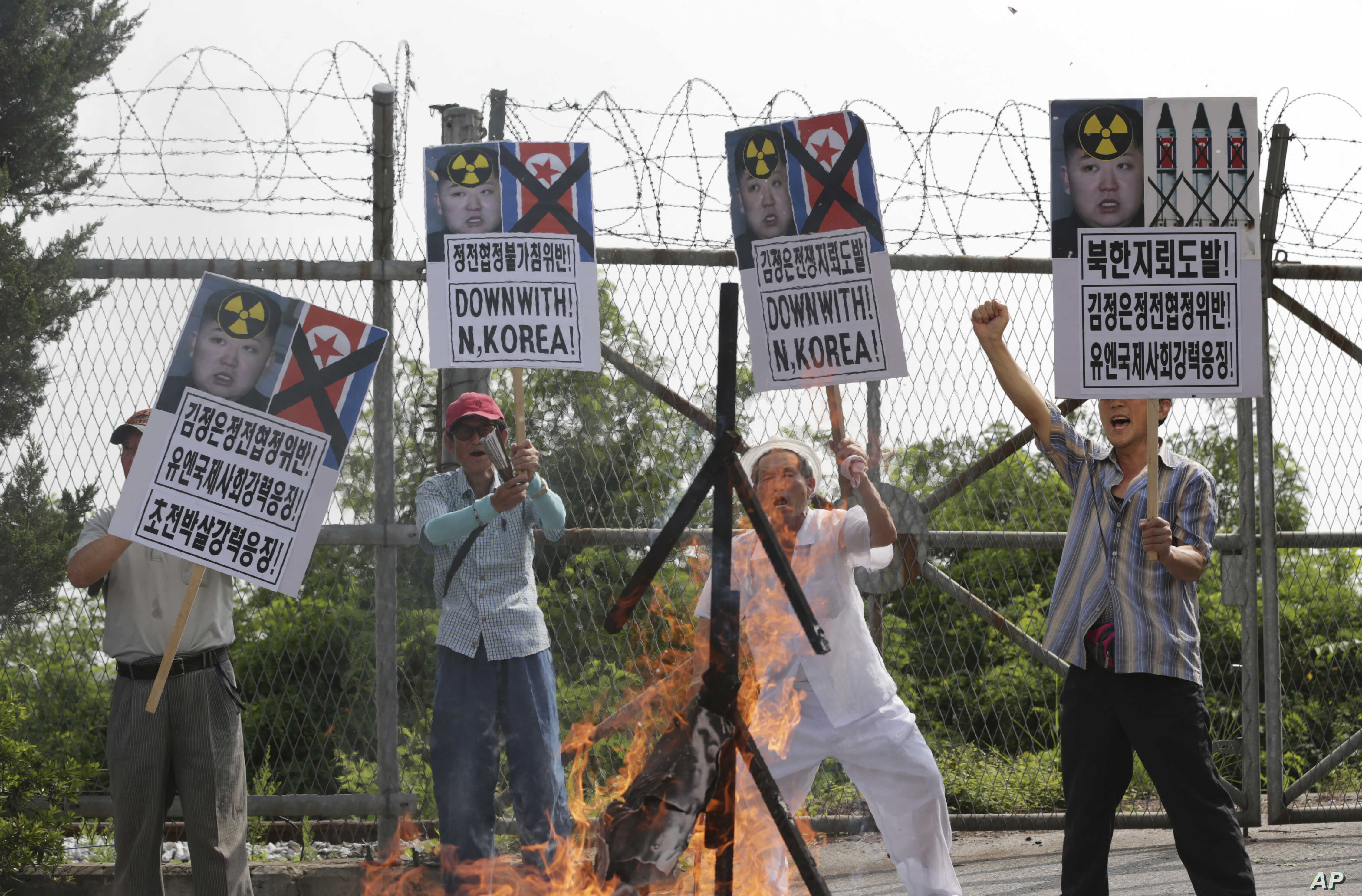 Members of South Korean conservative group shout slogans after burning an effigy of North Korean leader Kim Jong Un and North Korea's flag during a rally denouncing the North Korea at the Imjingak Pavilion near the border village of Panmunjom, which