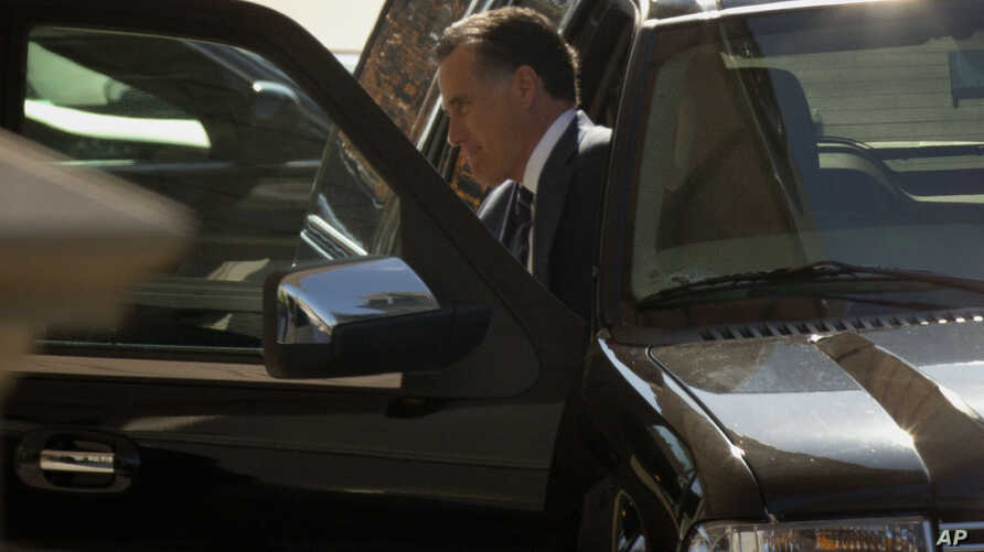 Former Republican presidential candidate Mitt Romney arrives at the White House in Washington, Nov. 29, 2012, for his luncheon with President Barack Obama