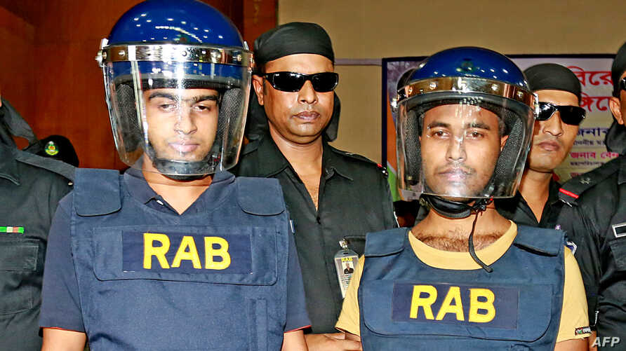 Abdul Hakim (L), 22, and Mahmudul Hasan, 17, members of homegrown banned militant outfit Jamaayetul Mujahideen Bangladesh (JMB) are presented to the media after they surrendered in Bogra on October 5, 2016.