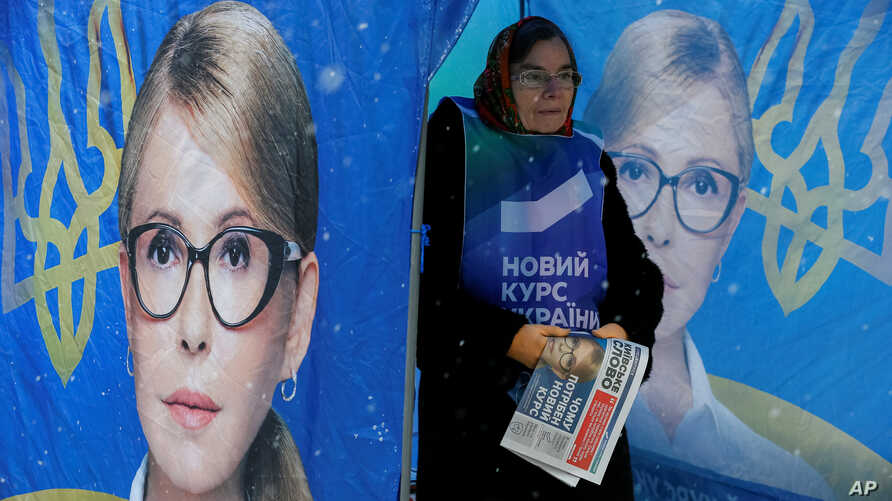 FILE - A campaign staffer stands in an election tent promoting Yulia Tymoshenko, a former prime minister and leader of Ukraine's Batkivshchyna (Fatherland) political party, in central Kyiv, Ukraine, Nov. 26, 2018.