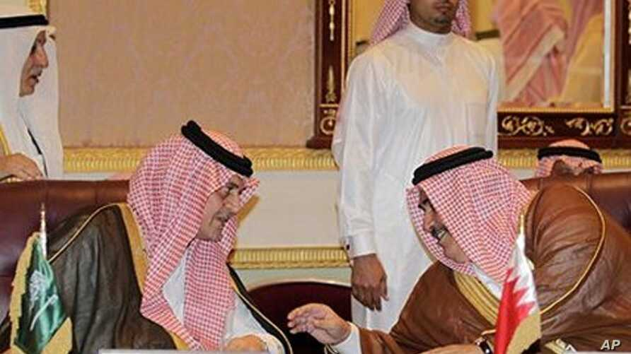 Saudi FM Prince Saudi al-Faisal, left, speaks with Bahrain's FM Sheikh Khaled bin Ahmad al-Khalifa, left, before the foreign ministers of the Gulf Cooperation Council 'GCC', in Riyadh, Saudi Arabia, May 1, 2011