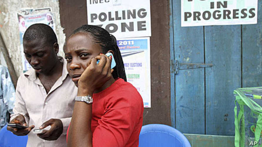 An election officer in Nigeria's commercial capital, Lagos, makes a phone call after the postponement of parliamentary elections, April 2, 2011