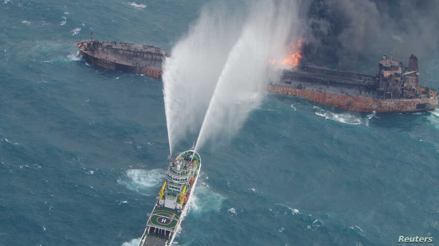A rescue ship works to extinguish the fire on the Iranian oil tanker Sanchi in the East China Sea, Jan. 10, 2018.