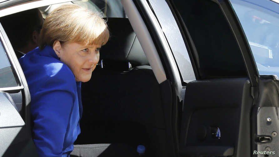 German Chancellor Angela Merkel arrives to attend a summit to discuss the conflict in Ukraine at the Elysee Palace in Paris, France, Oct. 2, 2015.