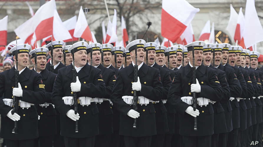 Polish Army soldiers salute during the official ceremony marking Poland's Independence Day, in Warsaw, Nov. 11, 2018.