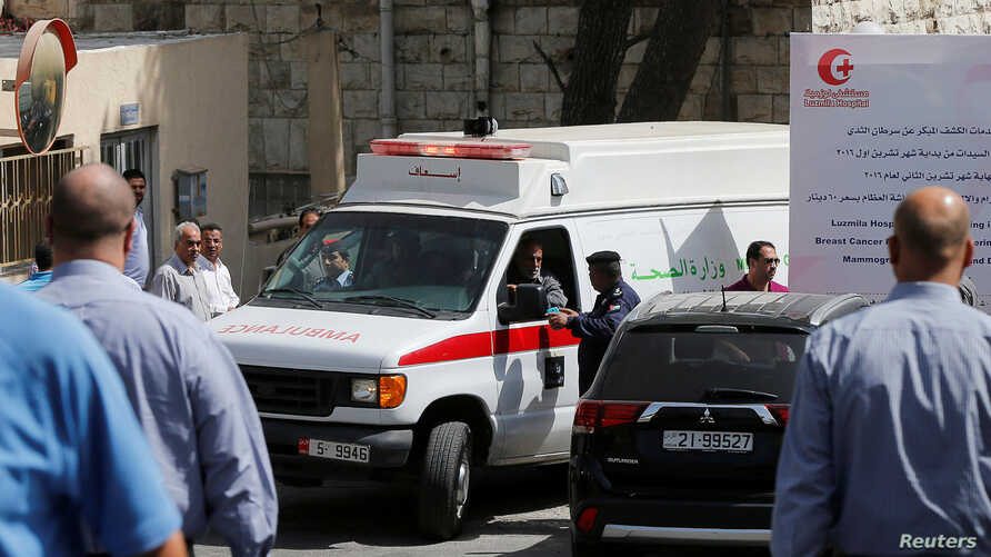 An ambulance transports the body of Jordanian writer Nahed Hattar to a medical facility after he was shot dead in Amman, Jordan, Sept. 25, 2016.