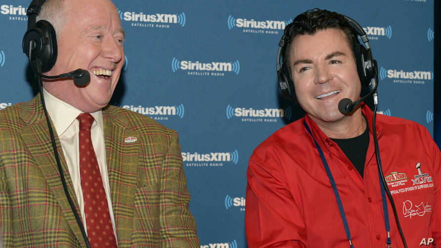 FILE - Papa John's founder John Schnatter, right, and former football star Archie Manning talk on NFL Radio Row during Super Bowl Week on Jan. 30, 2014, in New York.