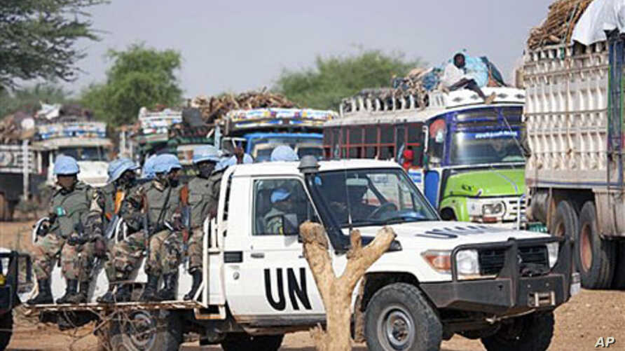 Rwandan troops with the UN-African Union peacekeeping operation in Darfur [UNAMID] escort returnees during a repatriation operation for more than 200 displaced families returning from Aramba to their original village in Sehjanna, north Darfur, Sudan,