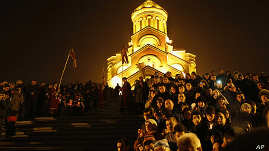 Georgians attend Orthodox Christmas celebrations at the Holy Trinity Cathedral in Tbilisi, early Saturday, Jan. 7, 2012. Christmas falls on Jan. 7 for Orthodox Christians that use the old Julian calendar instead of the 16th-century Gregorian calendar