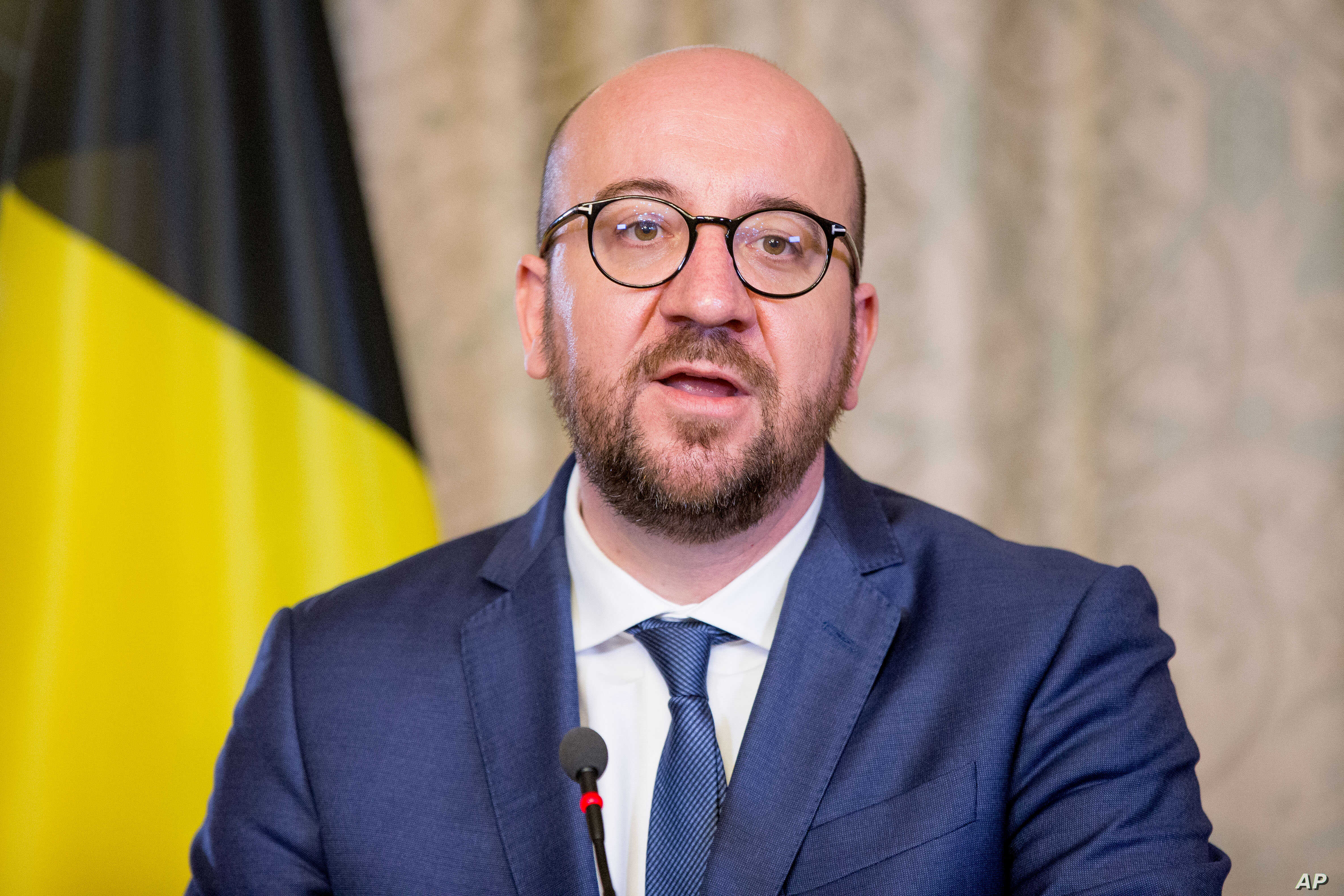 """FILE - Belgian Prime Minister Charles Michel is pictured at his official residence in Brussels, March 25, 2016. Belgian government officials said Wednesday that there were """"absolutely no"""" specific indications Michel was under a terrorist threat."""