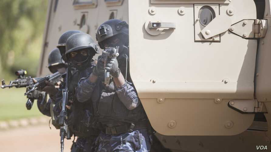 A Burkinabe police officer with the Special Intervention Unit fires his AK-47 rifle during a simulated terrorist attack as part of exercise Flintlock 2019 in Ouagadougou, Burkina Faso, Feb. 27, 2019. Members of the SIU were the first responders to th