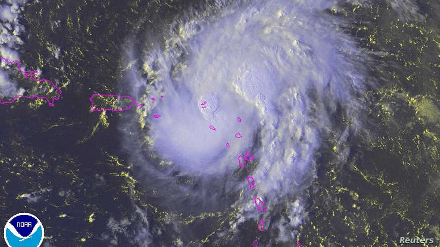 Tropical Storm Gonzalo is seen over the Caribbean Ocean in this NOAA satellite image taken at 16:15EDT (20:15GMT)  Oct. 13, 2014.
